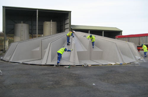 Site assembly of GRP cover.